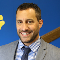 Principal Peter Fragola standing in main entry.