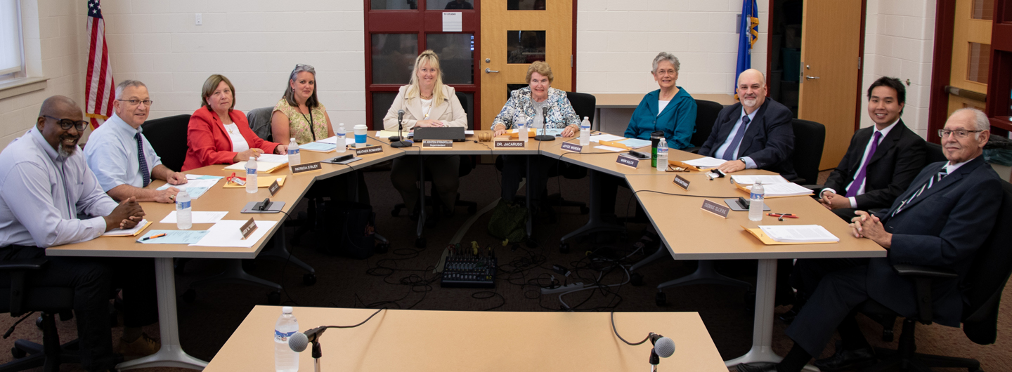Board of Education members sitting at a table